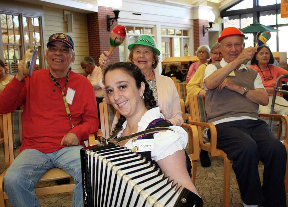 Waveny LifeCare Network's residents, short-term rehab patients and Adult Day Program participants celebrated Oktoberfest on Oct. 12 with a fun-filled day of German tradition. They explored the history of Oktoberfest, enjoyed live accordion music and sampled an array of tasty German food. Staff and friends dressed in traditional German dirndl and lederhosen to celebrate the occasion and spread cheer with song, polka and dancing. Photo: Contributed Photo