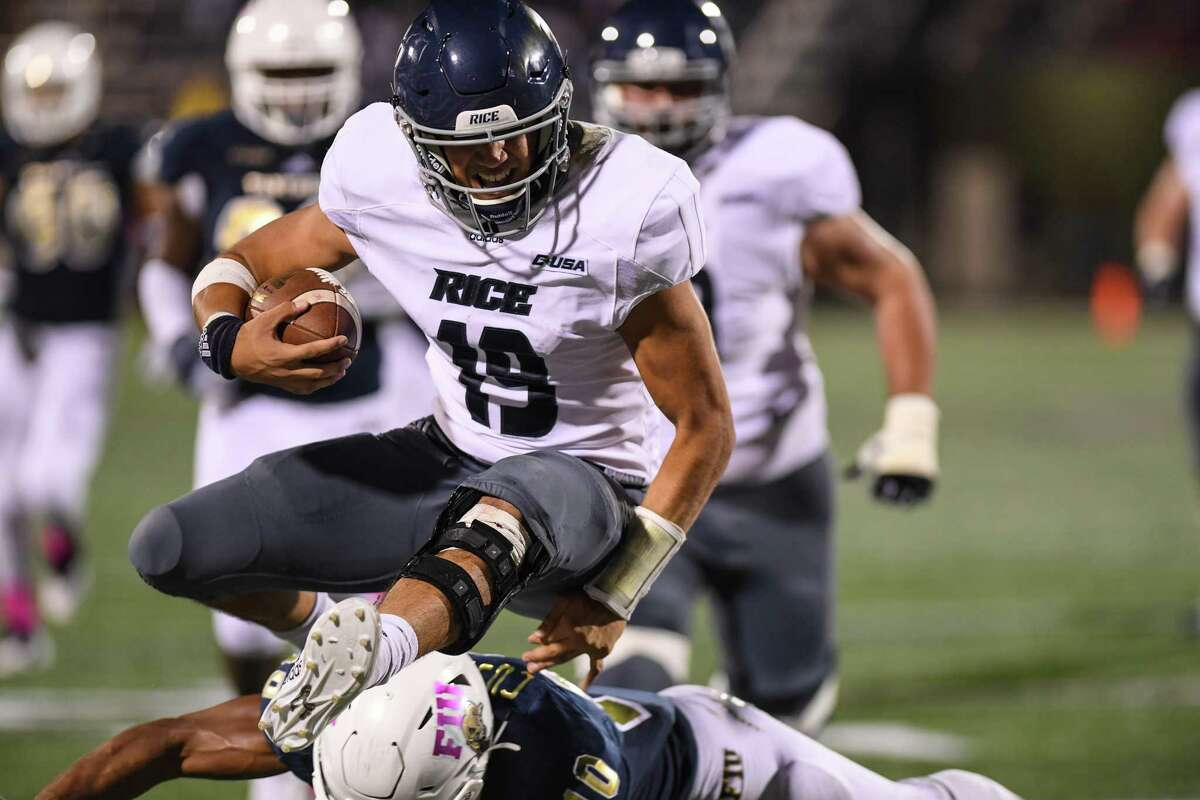 MIAMI, FL - OCTOBER 20: Evan Marshman #19 of the Rice Owls runs for a touchdown in the second half against the FIU Golden Panthers at Ricardo Silva Stadium on October 20, 2018 in Miami, Florida.