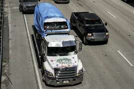 The van that federal agents are investigating in connection with package bombs that were sent to high-profile critics of President Donald Trump is transported on a  flatbed tow truck on Friday, Oct. 26, 2018 in Miramar, Fla.  Federal authorities took Cesar Sayoc into custody Friday in connection with the mail-bomb scare that earlier widened to 12 suspicious packages sent to prominent Democrats from coast to coast.  (Carline Jean/South Florida Sun-Sentinel via AP)