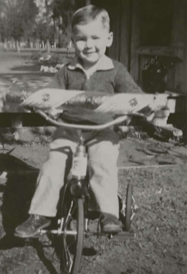 Fred Greer at about three years old with a large peppermint candy at the Humble Oil Camp.