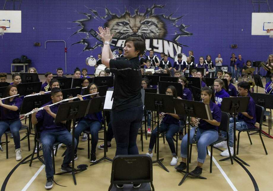 Band Director Emily Hicks cheers as the school's honor band is recognized during a pep rally at Lynn Lucas Middle School on Friday, Oct. 24, 2018, in Willis. The band was selected as one of eight bands in the nation to take part in the Music For All National Festival in Indianapolis, Indiana. Photo: Jason Fochtman, Houston Chronicle / Staff Photographer / © 2018 Houston Chronicle