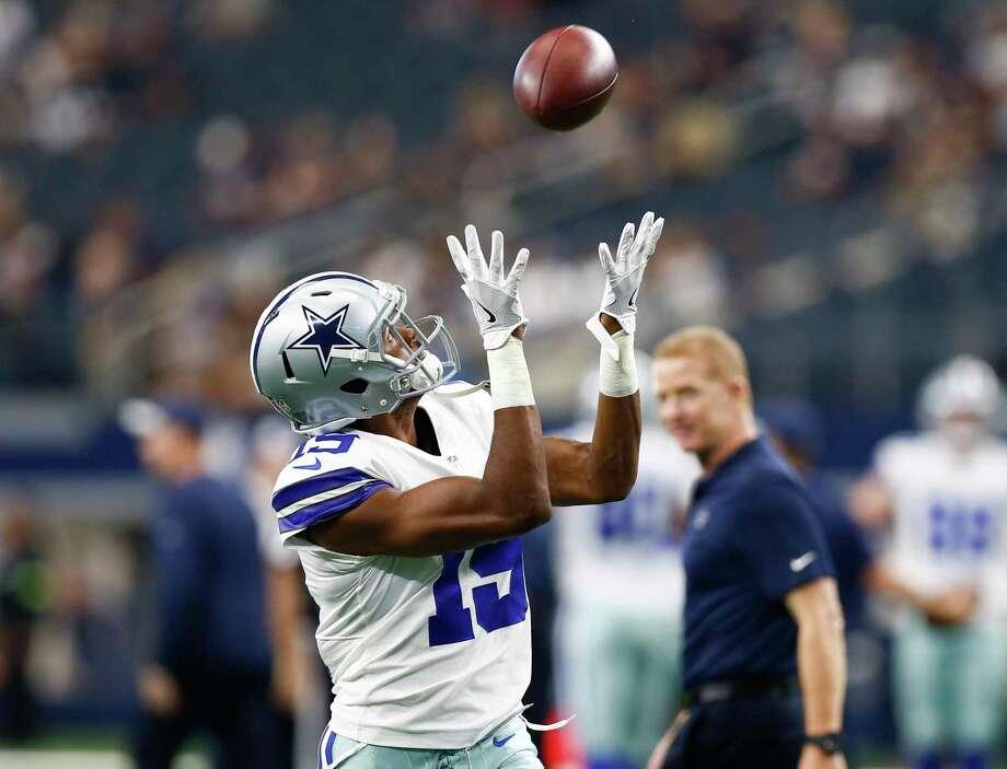 9feaac90e43 Dallas Cowboys wide receiver Brice Butler (19) catches a pass during team  warmups as