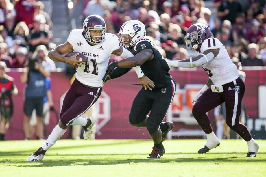 Texas A&M quarterback Kellen Mond (11) runs with the ball against South Carolina defensive lineman Brad Johnson (19) during the first half of an NCAA college football game Saturday, Oct. 13, 2018, in Columbia, S.C. (AP Photo/Sean Rayford) Photo: Sean Rayford, FRE / Associated Press / Copyright 2018 The Associated Press. All rights reserved.