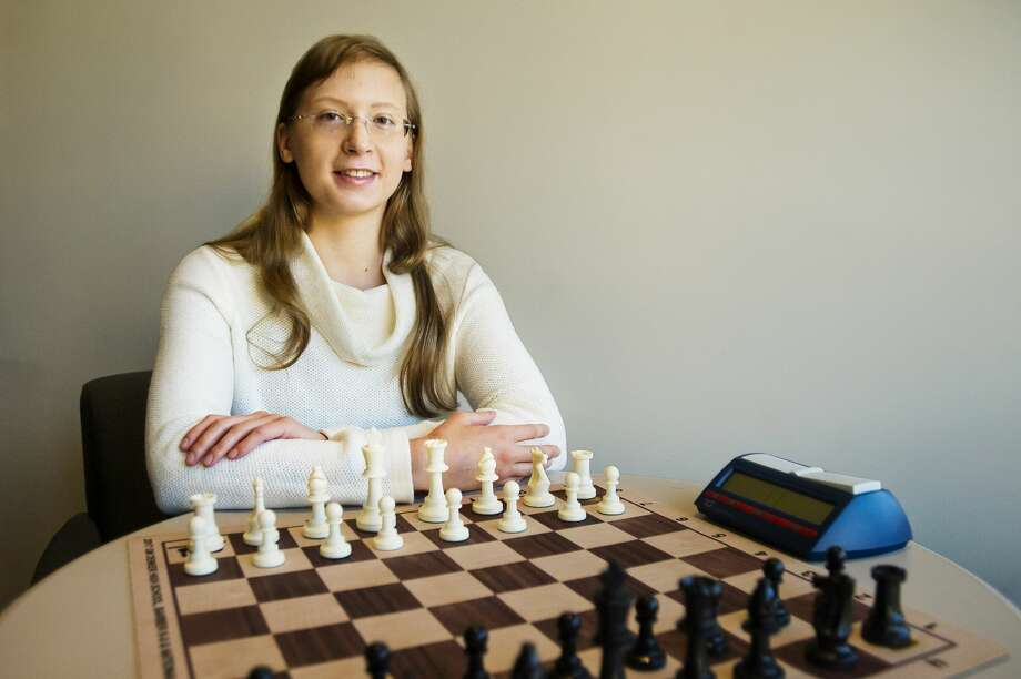 Sasha Konovalenko, a 16-year-old junior at H.H. Dow High School and competitive chess player, poses for a portrait at the Midland Daily News on Saturday, Oct. 20, 2018. At the recent Michigan Open in Cadillac, she finished fourth in the state open division, and for the third straight year she finished higher than any other woman. (Katy Kildee/kkildee@mdn.net) Photo: (Katy Kildee/kkildee@mdn.net)