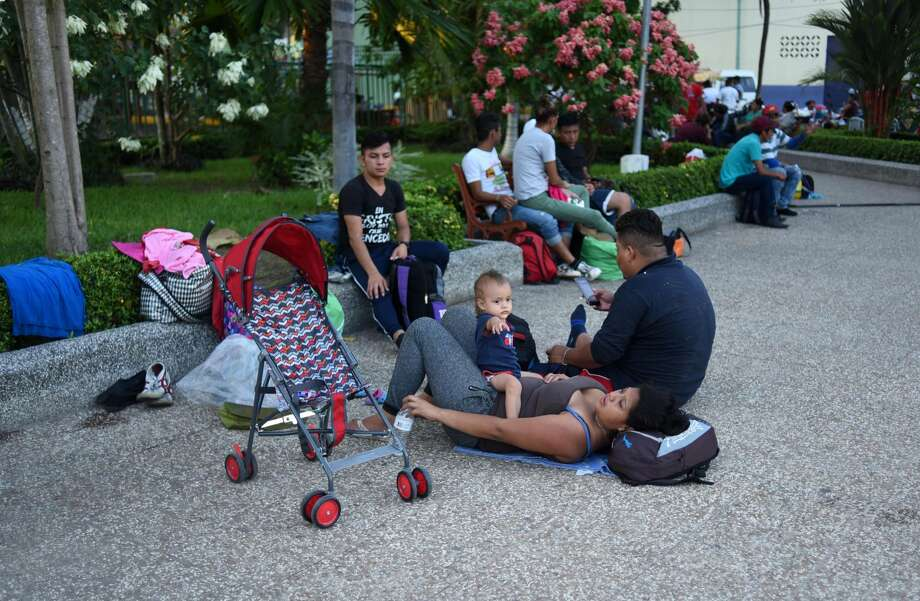 Honduran migrants heading in a caravan to the United States, rest at the central park of Ciudad Tecun Uman, Guatemala, in the border with Mexico, on October 25, 2018. - Thousands of Central American migrants crossing Mexico toward the United States in a caravan have resumed their long trek, walking about 12 hours to their next destination. (Photo by Johan ORDONEZ / AFP)        (Photo credit should read JOHAN ORDONEZ/AFP/Getty Images) Photo: JOHAN ORDONEZ/AFP/Getty Images