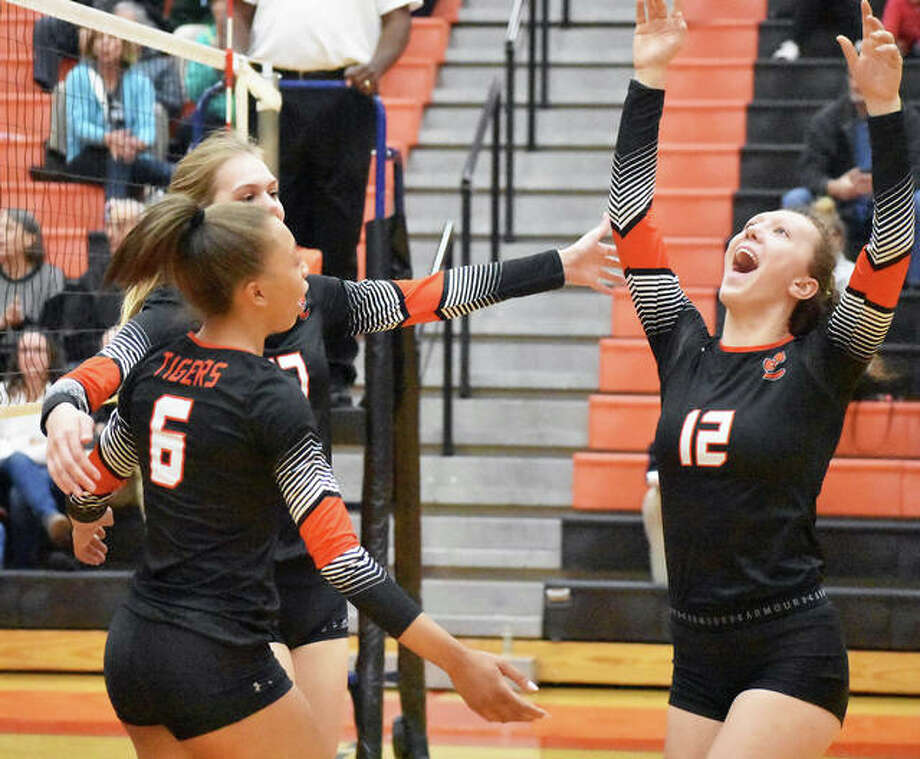 Edwardsville's Morgan Tulacro, right, celebrates with Alexa Harris and Storm Suhre during the second game against Springfield on Thursday inside Lucco-Jackson Gymnasium. Photo: Matt Kamp/Intelligencer