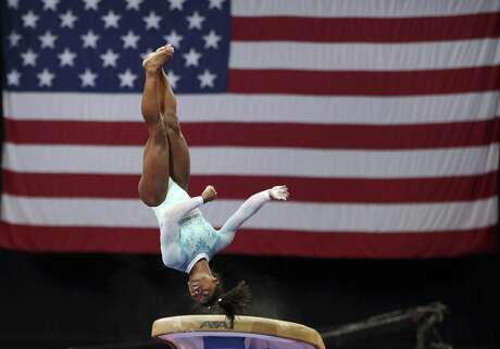 Simone Biles competes on the vault at the U.S. Gymnastics Championships, Sunday, Aug. 19, 2018, in Boston. (AP Photo/Elise Amendola)