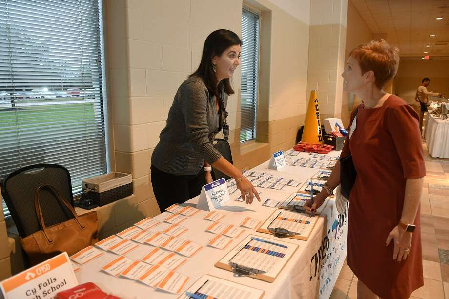Gaby Pozas, left, of the Cypress Fairbanks ISD Community Engagement department, checks in Julie Hinaman, who leads CFISD's Community Leadership Committee, at the CFISD School Priority Day event at Berry Center in Cypress on Oct. 25, 2018. Photo: Jerry Baker, Houston Chronicle / Contributor / Houston Chronicle