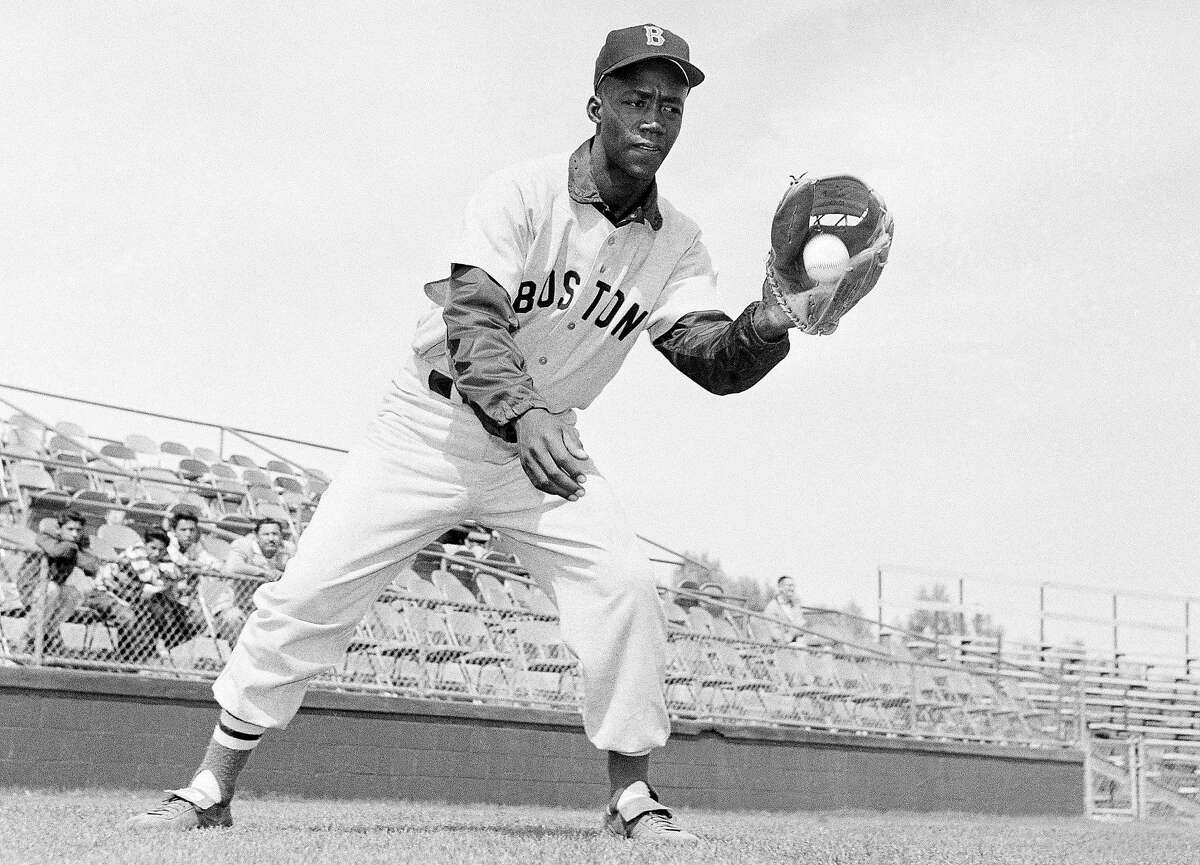 Elijah Pumpsie Green, of the Boston Red Sox, shown in action, April 20, 1959. (AP Photo/Harold Filan)