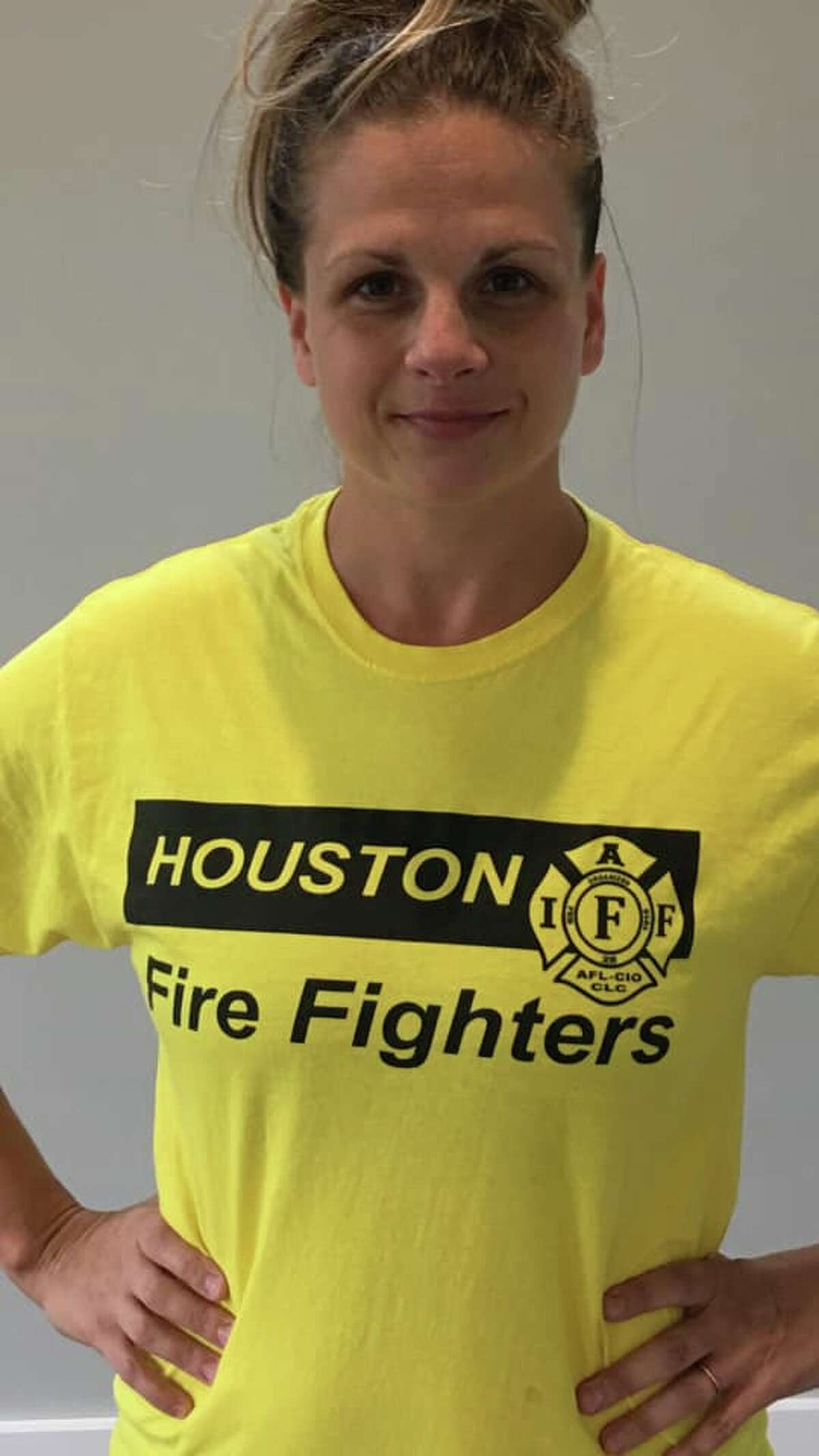 Jillian Ostrewich, the wife of a Houston firefighter, said she was asked to turn her Houston Fire Fighters shirt inside out at a polling station earlier this week, even thought the shirt didn't appear to break state election law. The fire union said around 25 other firefighters had been asked to cover their generic fire department shirts. >>>