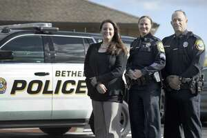 From left Bethel Police Sgt. Courtney Whaley, Lt. Heather Burnes and Sgt. Vincent Lajoie, Thursday, Oct. 25, 2018. The three have recently been promoted.