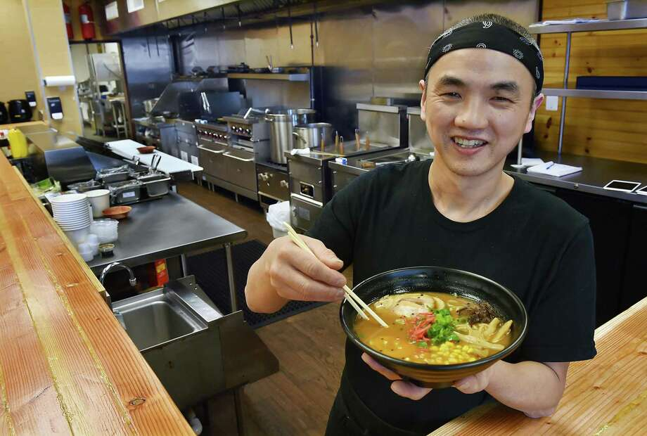 Orange resident Jimmy Pan, co-owner of Hokkaido Ramen at 297 Boston Post Road in Orange, displays a bowl of spicy miso ramen. Photo: Catherine Avalone / Hearst Connecticut Media / New Haven Register