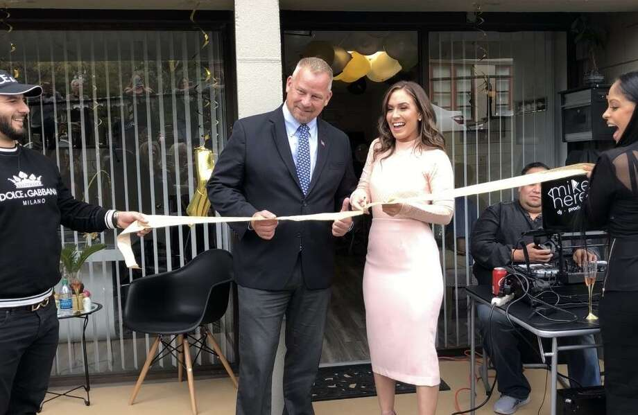 Derby Mayor Richard Dziekan, left, and Tiffany Russell cut the ribbon for the grand opening of Tiffany Russell Realty. Photo: Contributed Photo