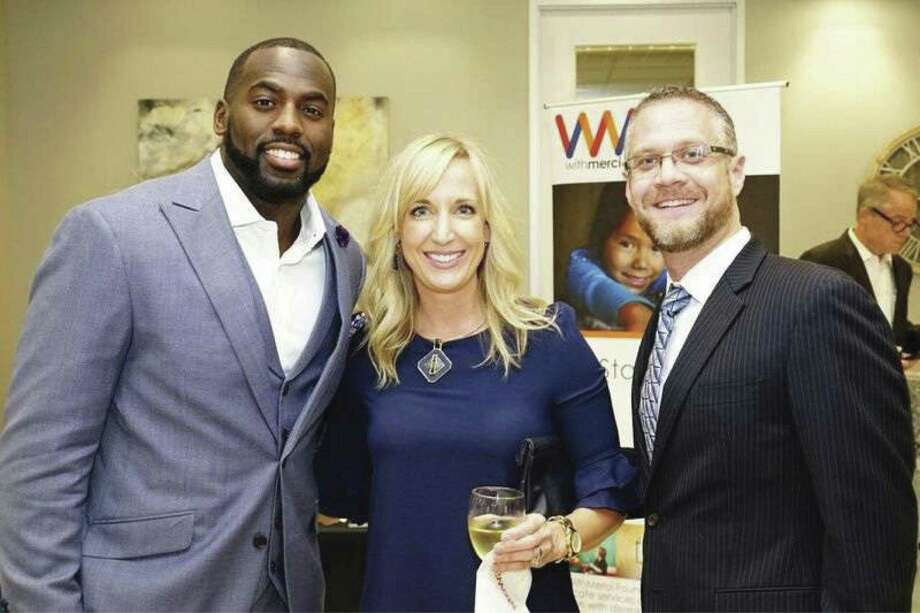 Whitney Mercilus, left, greets Dawn Johnson of Martha Turner Sotheby's International Realty and Clay Smith of Stewart Title.