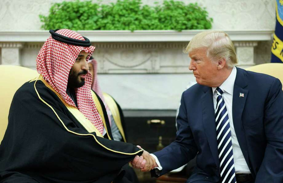 President Donald Trump shakes hands with Saudi Arabia's Crown Prince Mohammed bin Salman in the Oval Office on March 20. Readers ask for action from U.S. because of the death of U.S.-based journalist Jamal Khashoggi, allegedly at the behest of the crown prince. Photo: MANDEL NGAN /AFP /Getty Images / AFP or licensors
