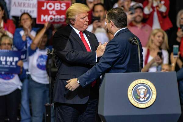 """President Donald Trump greets Sen. Ted Cruz during a campaign rally in Houston on Monday. Trump declared that he's a """"nationalist"""" at the rally as he appealed to Texas Republicans to re-elect Cruz and help the party keep control of Congress."""