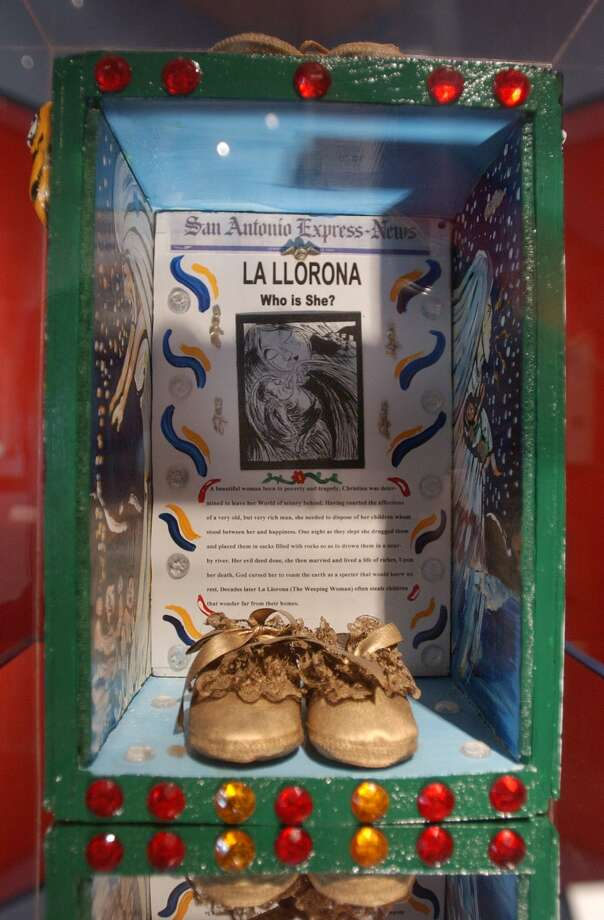 "Artist Xavier Garza's exhibit at the Institute of Texan Cultures in 2002 includes such legends as ""La Llorona,"" the crying ghost of a woman who legend says killed her children. Photo: BILLY CALZADA /SAN ANTONIO EXPRESS-NEWS"