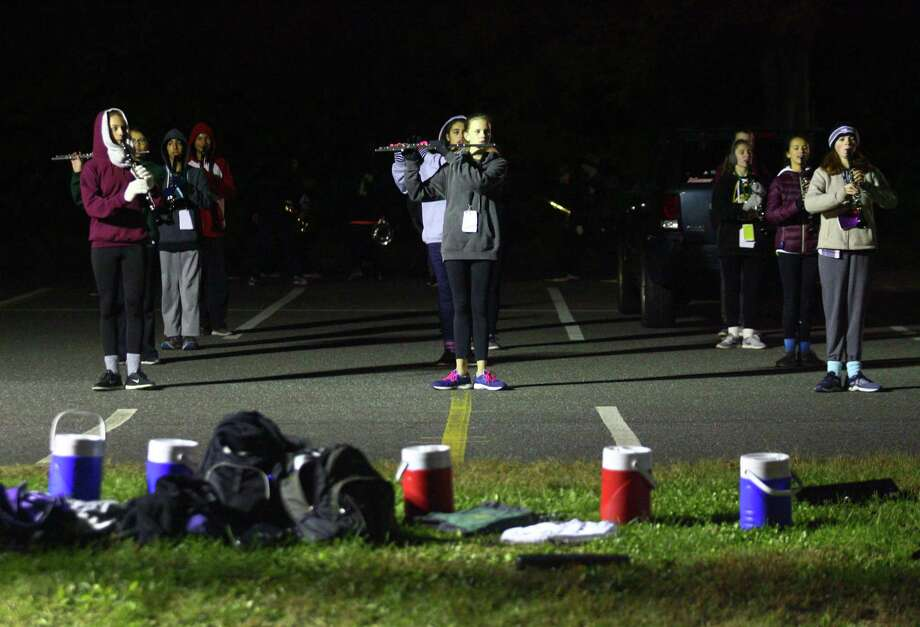 """Trumbull High's """"Golden Eagles"""" Marching Band practices at the school in Trumbull, Conn., on Thursday Oct. 25, 2018. They're facing three major championships coming up, the next one in New Britain on Saturday night. Photo: Christian Abraham / Hearst Connecticut Media / Connecticut Post"""