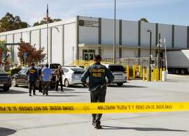 Emergency personnel monitor the scene after two suspicious packages addressed to Senator Kamala Harris and democratic activist and billionaire Tom Steyer at the U.S. Post Office at 1625 Rollins Road in Burlingame, Calif. Friday, Oct. 26, 2018.