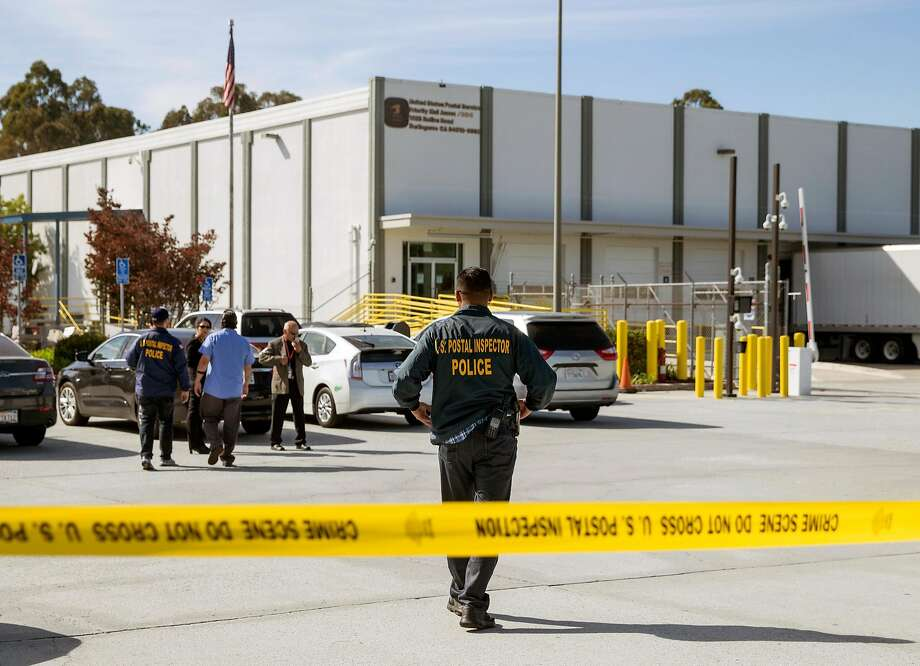 Emergency personnel monitor the scene after two suspicious packages addressed to Senator Kamala Harris and democratic activist and billionaire Tom Steyer at the U.S. Post Office at 1625 Rollins Road in Burlingame, Calif. Friday, Oct. 26, 2018. Photo: Jessica Christian / The Chronicle