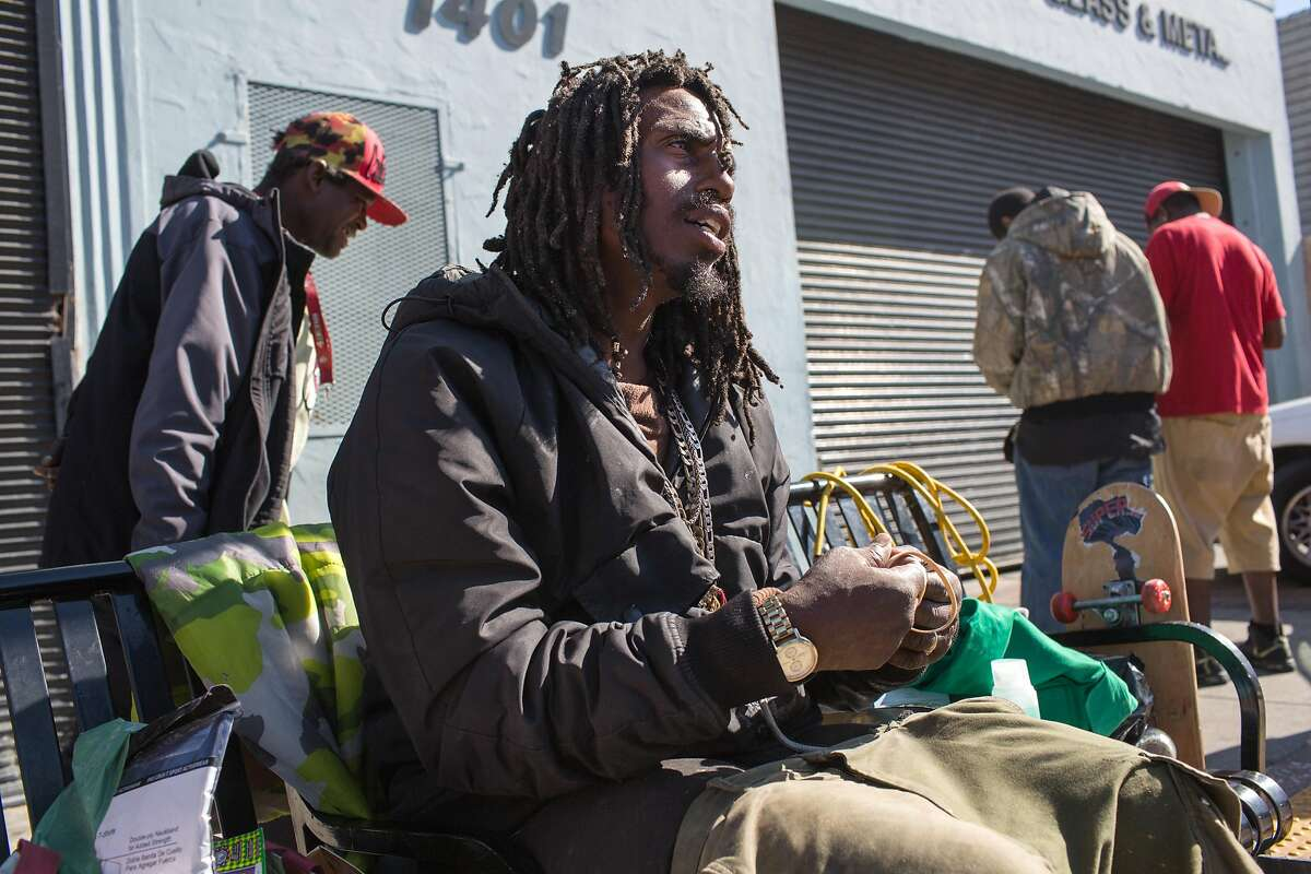Onnie P. Broussard, 37, talks to outreach specialists from the Homeless Outreach Team. Broussard grew up in the Bay View and has been on the street for almost 2 years. Bay View on Monday, September 24, 2018 in San Francisco Calif.