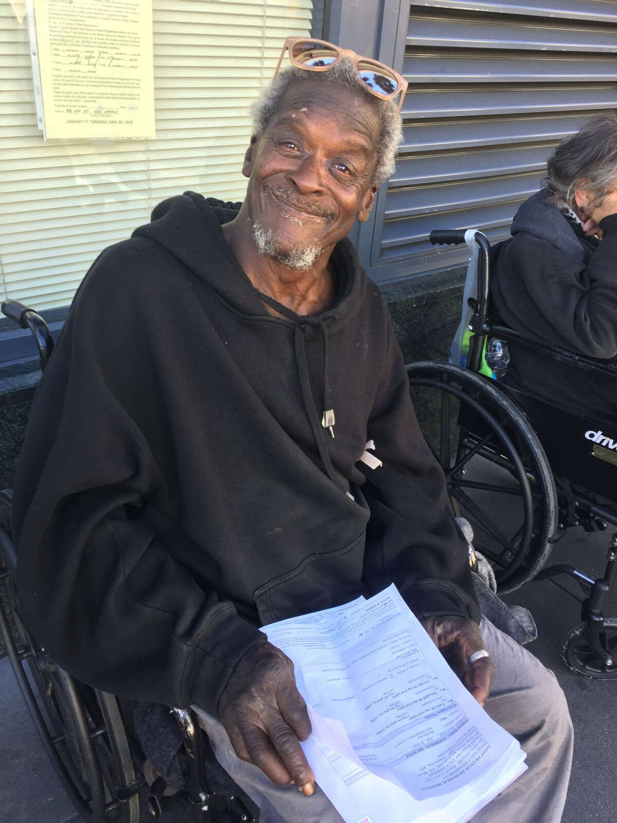 Michael Goodman, 69, was born in San Francisco in 1949. He has lived on the streets for three years and in an interview with SFGATE on Oct. 25, 2018, he was sharing papers with information on all the medications he takes for the chronic obstructive pulmonary disease he suffers from. He's in a wheelchair. He told SFGATE he studied electronics at a college in Los Angeles before going to work for Howard Hughes Aircraft Company.
