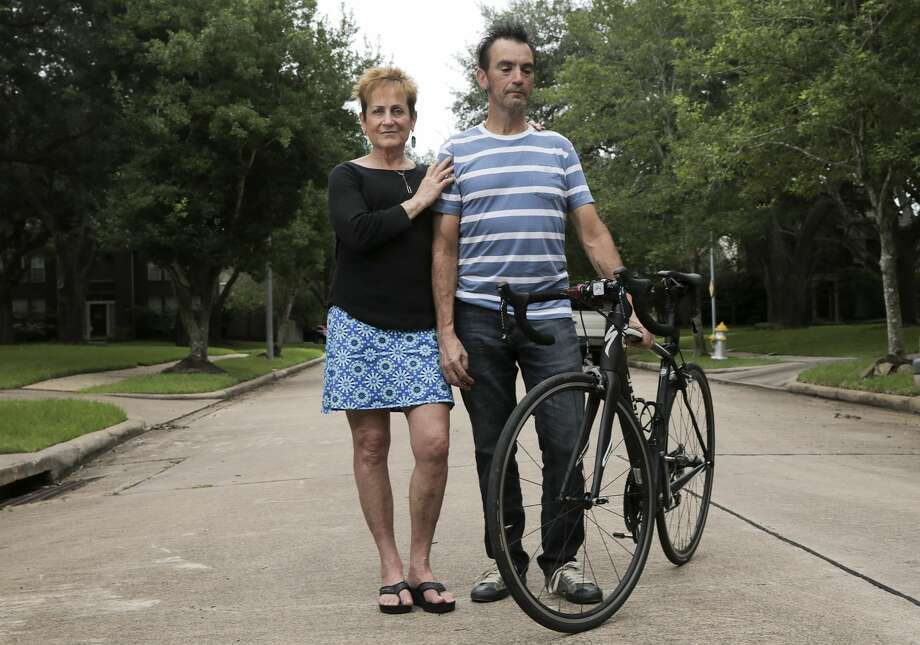 Joyce Baysinger and her husband, Doug, outside of their Sugar Land home. The two had major injuries after being hit by a drowsy driver while they were bicycle riding with a group in 2016. Photo: Elizabeth Conley/Staff Photographer