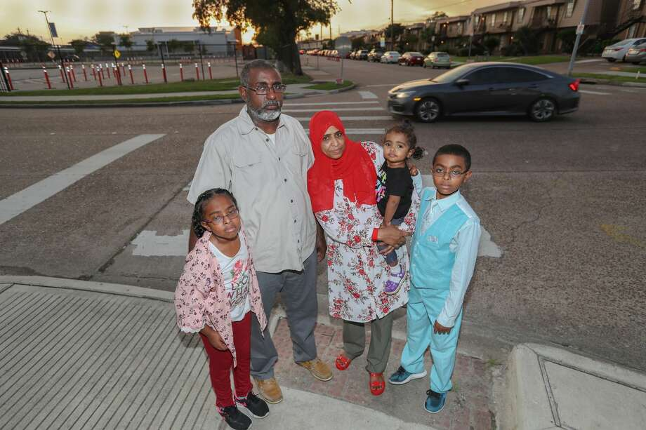 Rawan Ali Abdalla, 8, (l-r) Abohiada Ali Abdalla, Rahuf, 2, Wigdan Ahmed Mohammed and Osman Ali Abdalla, 12, stand at the crosswalk where their family member was killed two years ago in Houston. Mohammed Ali Abdalla, died 2 years ago after he was hit in a crosswalk. He was 4 years old. Photo: Steve Gonzales/Staff Photographer