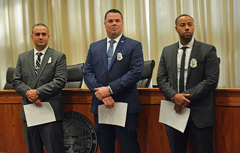 Middletown Mayor Dan Drew swore in three veteran officers Friday afternoon at City Hall Council Chambers, bringing the ranks to 112. From left, Mark Kominske came from Plainville police, Jason Bodell from Cheshire and Jeremy Tavares from the New Haven force. Photo: Cassandra Day / Hearst Connecticut Media