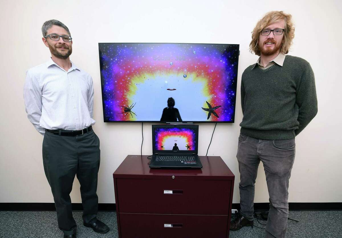 Eli Lebowitz, left, director of Program for Anxiety Disorders at the Yale Child Study Center, and Bernard Francois, founder and CEO of PreviewLabs, stand with the behavioral assessment game YIKES (Yale Interactive Kinect Environment Software) that they developed.