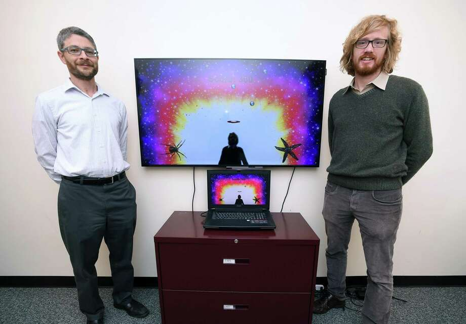 Eli Lebowitz, left, director of Program for Anxiety Disorders at the Yale Child Study Center, and Bernard Francois, founder and CEO of PreviewLabs, stand with the behavioral assessment game YIKES (Yale Interactive Kinect Environment Software) that they developed. Photo: Arnold Gold / Hearst Connecticut Media / New Haven Register