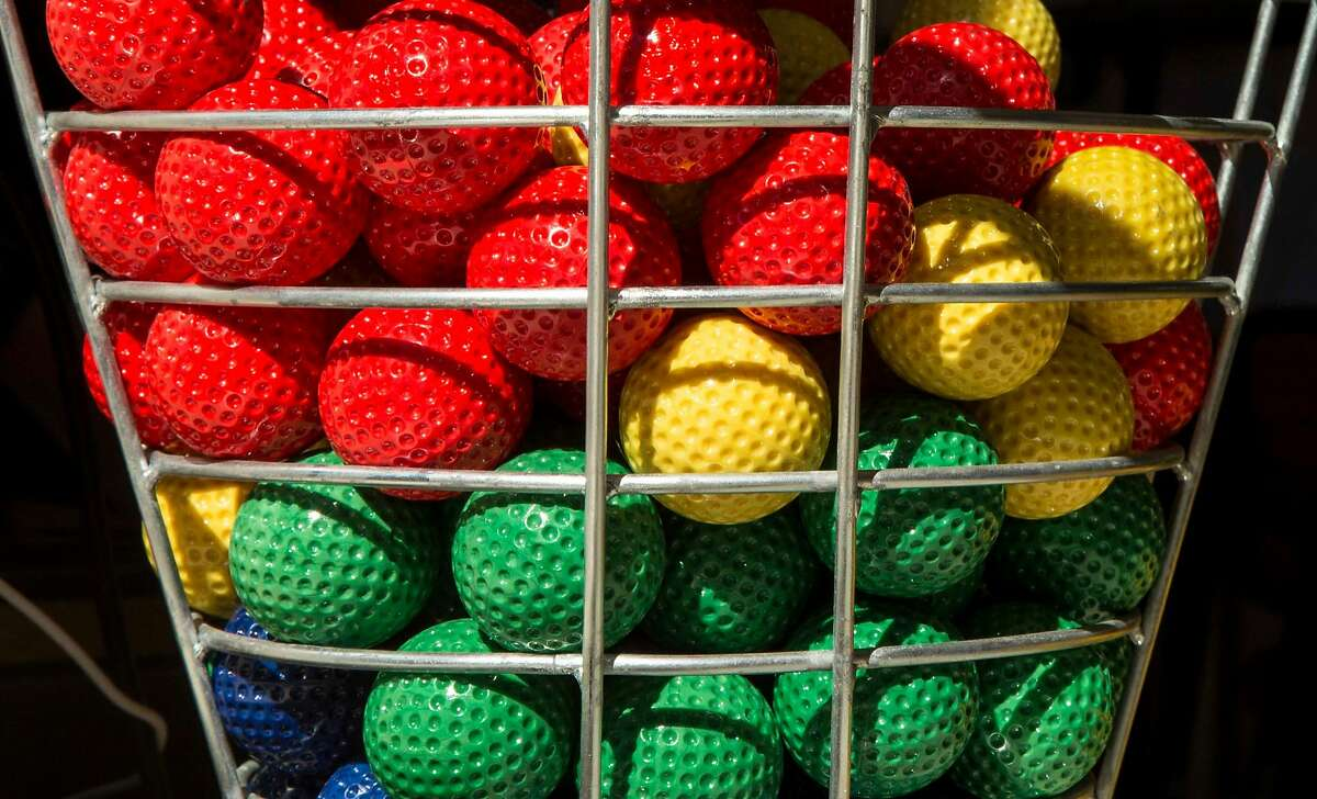 Colorful golf balls sit in a basket for guests at the main entrance of Stagecoach Greens in San Francisco, Calif. Saturday, Oct. 13, 2018.