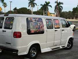 In an undated photo provided by David Cypkin, a van which apparently belonged to Cesar Sayoc, the suspect held over a string of package bombs. Eight of the van's10 windows were nearly completely covered with stickers expressing support for President Trump; several stickers showed recipients of the bombs, in crosshairs. (David Cypkin via The New York Times) -- NO SALES; FOR EDITORIAL USE ONLY WITH PACKAGE BOMBS VAN BY HARMON FOR OCT. 27, 2018. ALL OTHER USE PROHIBITED. --