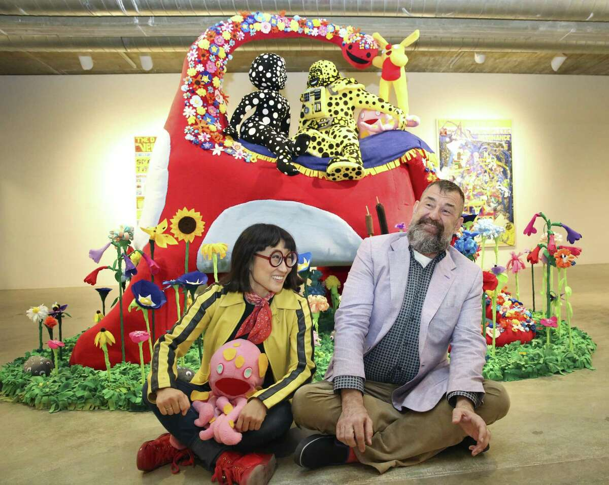 """Artist Joo Young Choi and Contemporary Arts Museum Houston Director Bill Arning grooving in front of her """"Time for You and Joy to Get Acquainted"""" artwork for the """"A Better Yesterday"""" exhibition in 2017."""