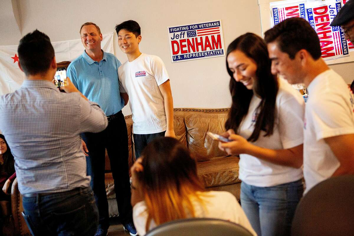 Rep. Jeff Denham takes photos with his supporters and volunteers at his campaign field office on Saturday, Oct. 20, 2018, in Banta, Calif.