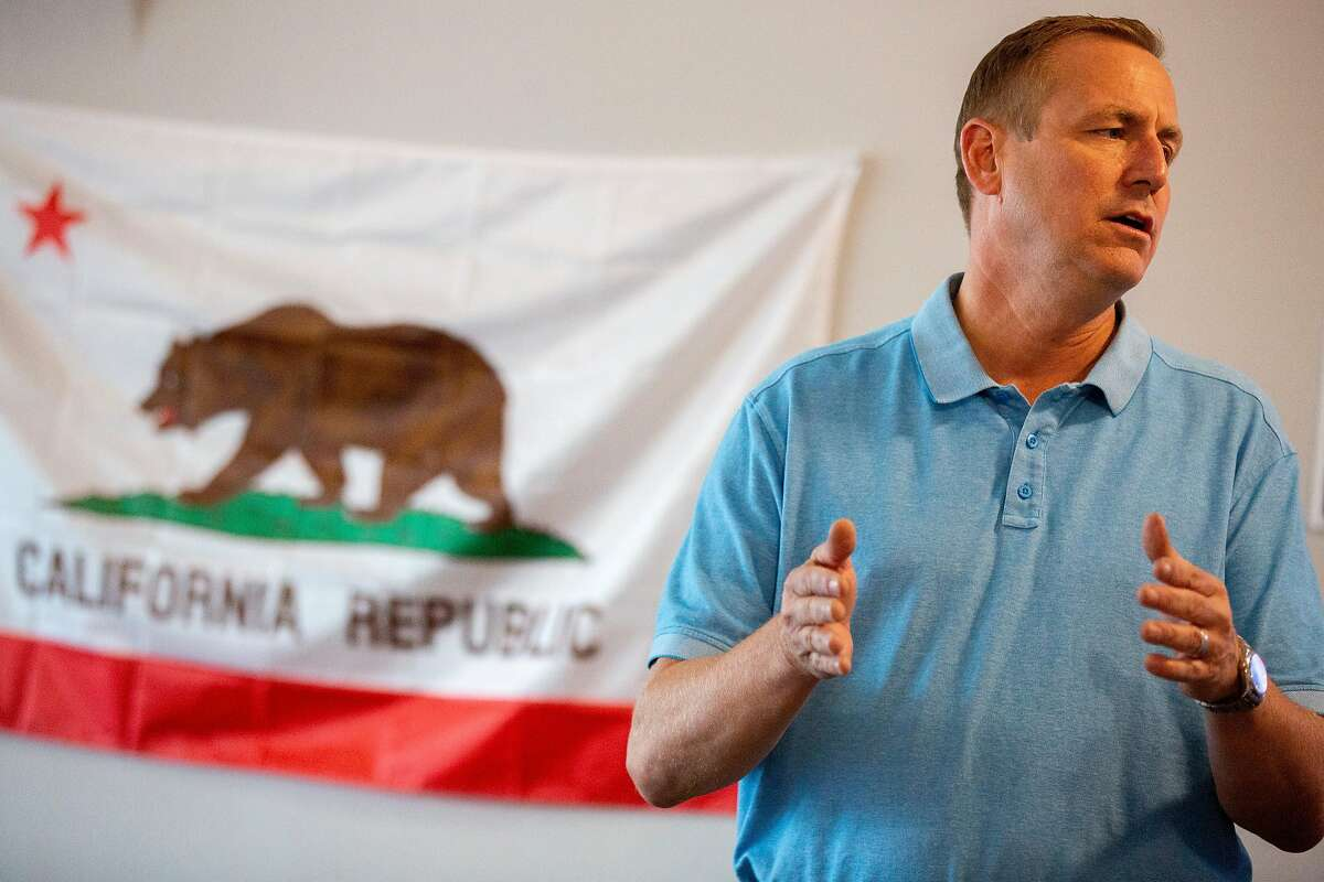 Rep. Jeff Denham chats with his volunteers at his campaign field office on Saturday, Oct. 20, 2018, in Banta, Calif.