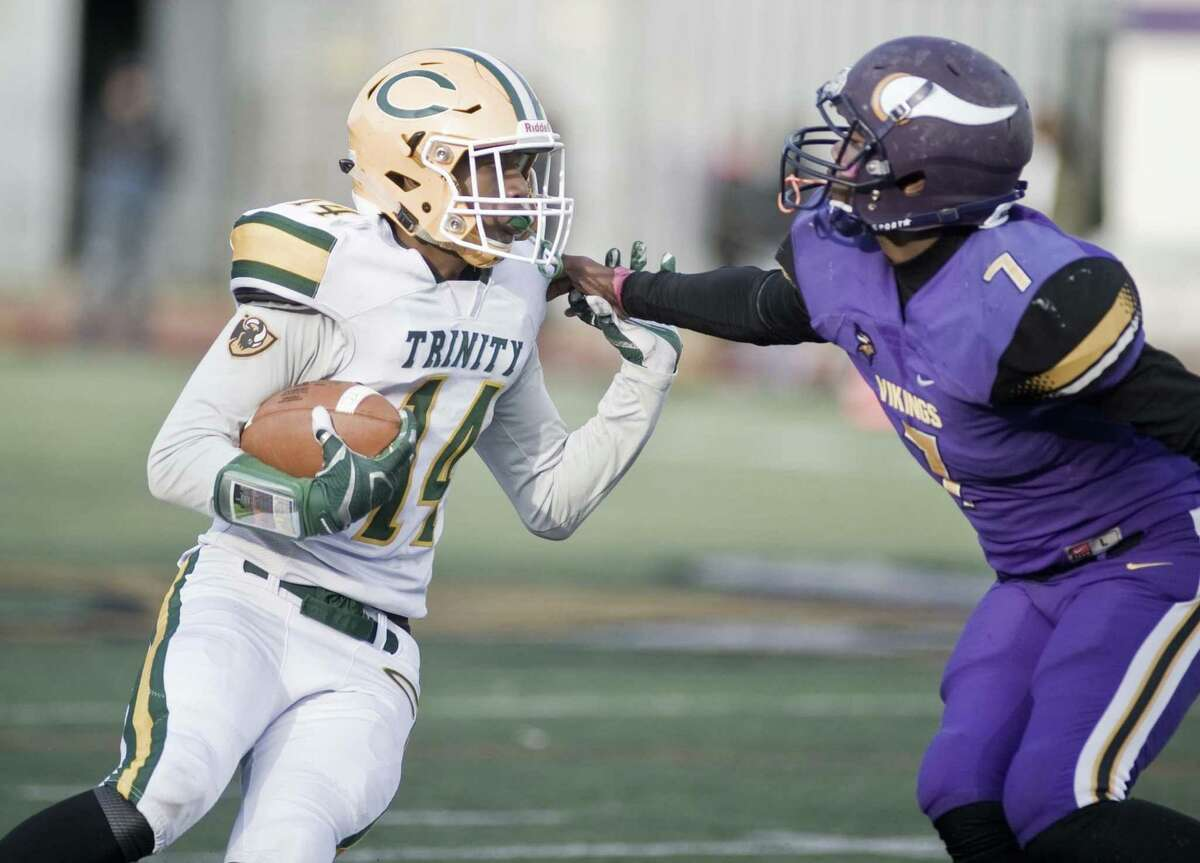 Trinity Catholic's Xavier Ruilliano tries to get by Westhill's Leshaun Ware in a game at Westhill on Friday.
