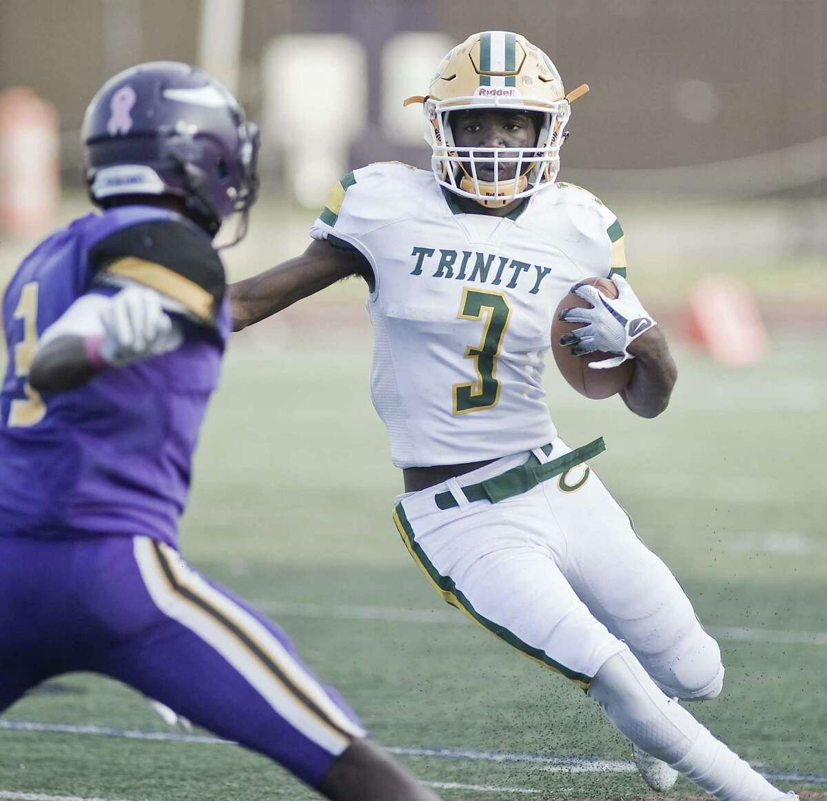 Trinity Catholic's Tahj Morgan looks for an opening during a game against host Westhill on Friday in Stamford. Trinity Catholic topped city rival Westhill, 22-7.