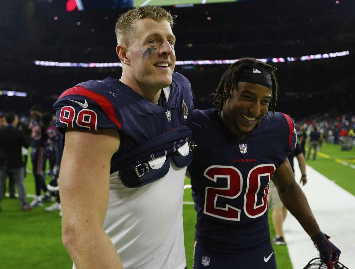 Houston Texans defensive end J.J. Watt (99) and defensive back Justin Reid (20) walk off the field following the Texans win at NRG Stadium on Thursday, Oct. 25, 2018, in Houston.