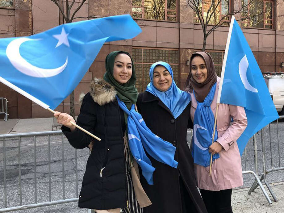Aydin Anwar, right, with her mother, Gulzighra Abdushukur, center, and her sister Ephar Anwar, left, protest China?s crackdown on Uighurs in New York City in March 2018. Photo courtesy of Aydin Anwar