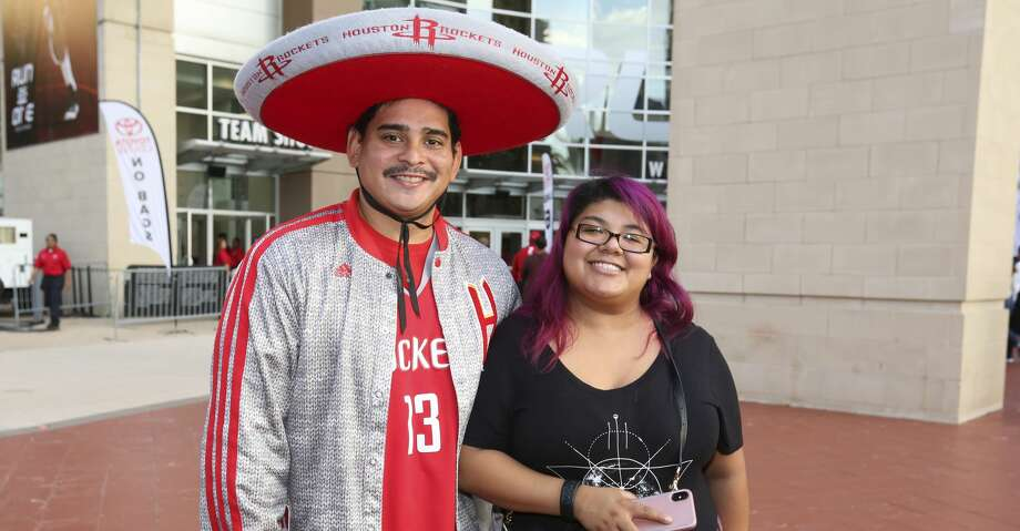 Houston Rockets fans pose for a photograph before the NBA game against the LA Clippers at Toyota Center on Friday, Oct. 26, 2018, in Houston. Photo: Yi-Chin Lee/Staff Photographer