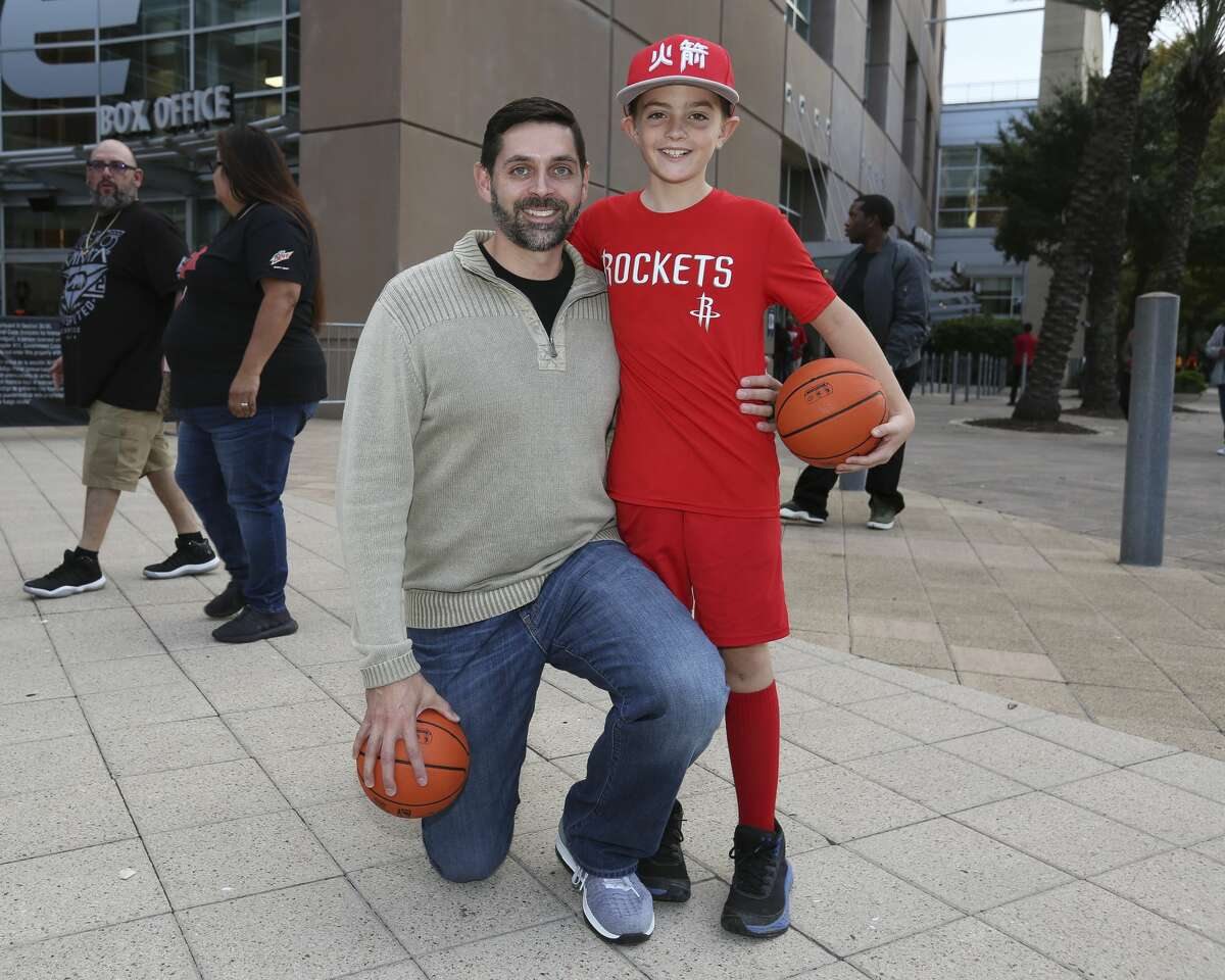 Houston Rockets fans pose for a photograph before the NBA game against the LA Clippers at Toyota Center on Friday, Oct. 26, 2018, in Houston.