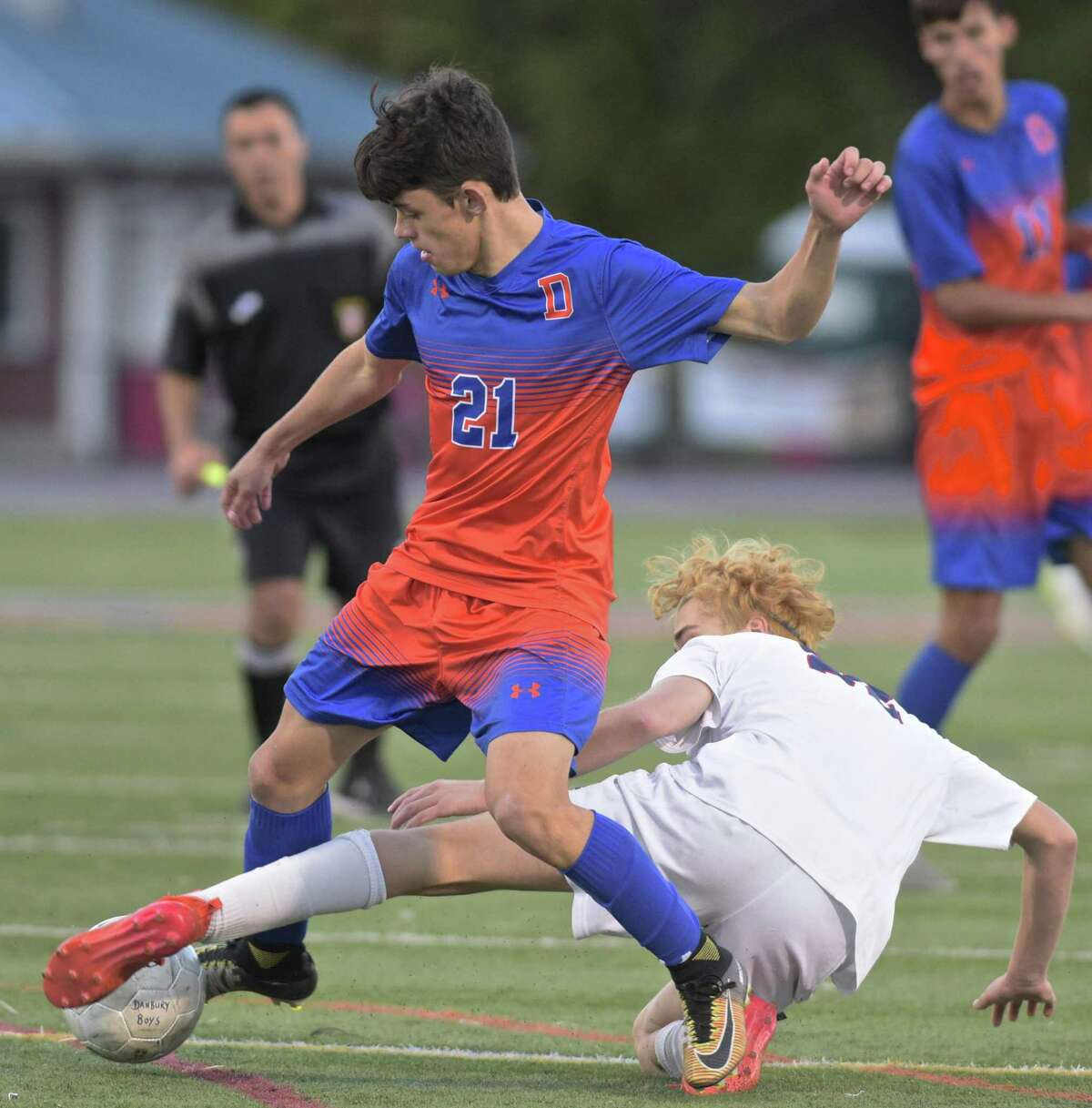 Danbury's Lucas Oliveira (21) and McMahon's Lucas Balderrama (22) battle for the ball in the FCIAC boys Soccer game between Brien McMahon and Danbury high schools, Friday afternoon, October 26, 2018, at Danbury High School, Danbury, Conn.