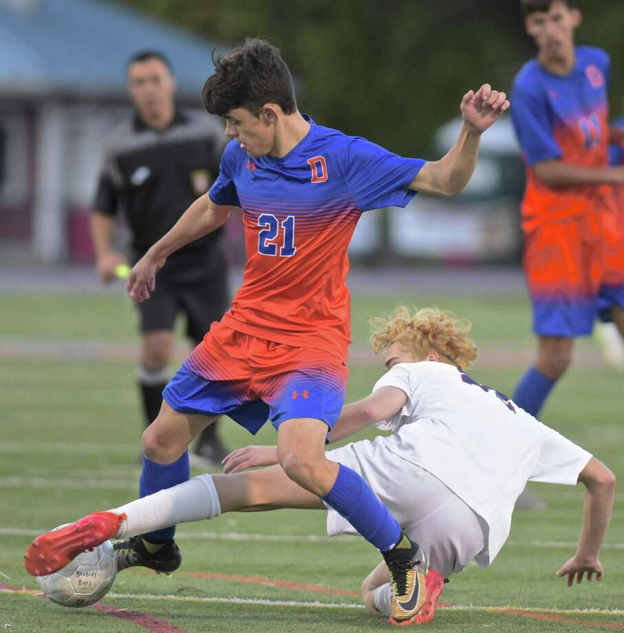 Danbury's Lucas Oliveira (21) and McMahon's Lucas Balderrama (22) battle for the ball in the FCIAC boys Soccer game between Brien McMahon and Danbury high schools, Friday afternoon, October 26, 2018, at Danbury High School, Danbury, Conn. Photo: H John Voorhees III / Hearst Connecticut Media / The News-Times