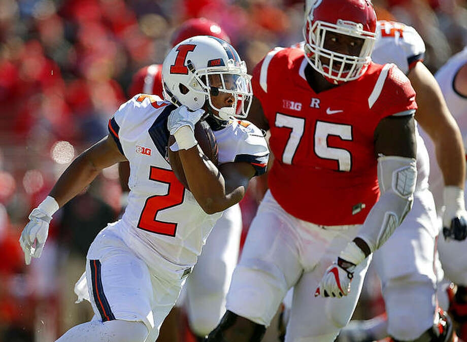 Reggie Corbin of Illinois (2) runs for yardage earlier this season against Rutgers. Maryland native Corbin and his Illini teammates will play at Maryland Saturday. Photo: AP Photo