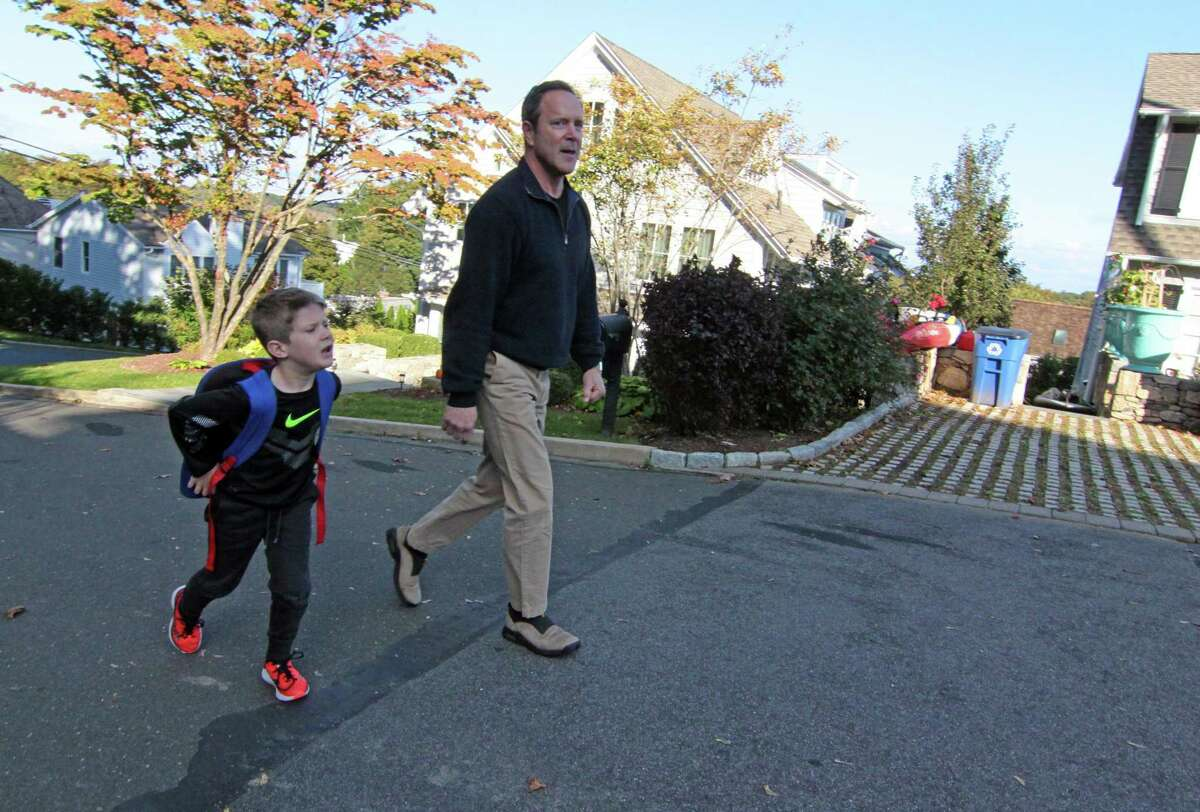 Greg Zola walks home from the bus stop with his son Luke, 7, near their home in Westport, Conn. on Wednesday, Oct. 24, 2018. Zola and his husband Dr. Mark Leondires' children Luke and Owen, 5, were conceived with the help of reproductive medicine technology. Dr. Leondires is the Medical Director of Reproductive Medicine Associates of Connecticut and the founder of Gay Parents to Be, an international program serving the LGBTQ community offered through RMA of Connecticut.