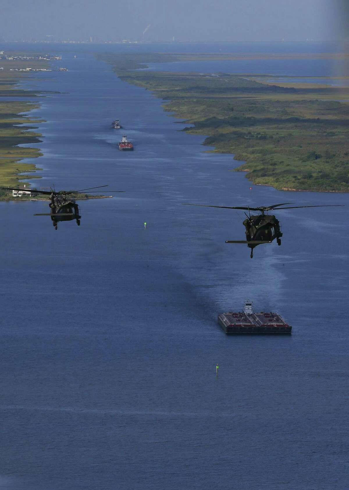 Army Black Hawk helicopters, carrying U.S. Army Corps of Engineers officials, flies over the Bolivar Peninsula Wednesday, September 7, 2016.