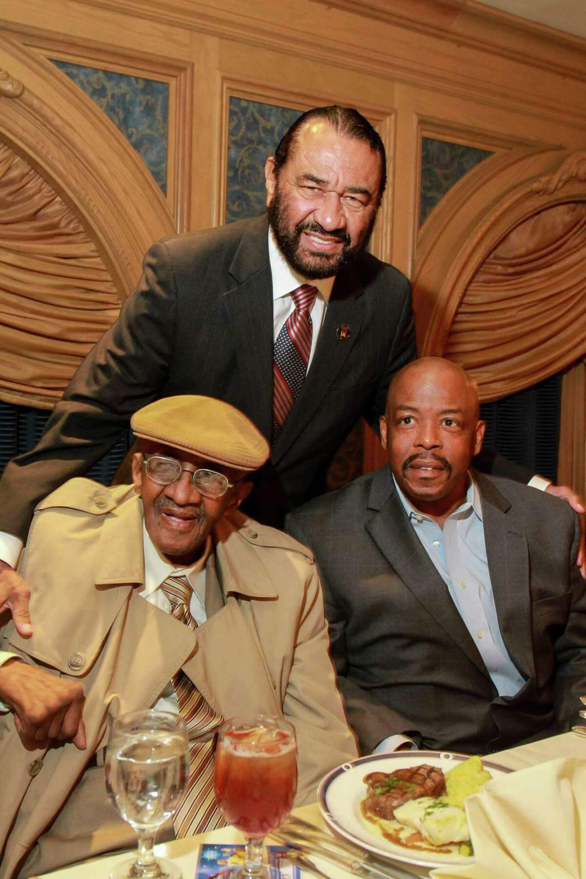 Ovide Duncantell, Jr., founder and executive director of the Black Heritage Society, Inc., from left, Congressman Al Green, and Sylvester Brown, senior operations manager at Black Heritage Society, Inc., at BHS's Mountaintop Awards Luncheon, honoring Kenny Washington, the first African American player to sign a contract with the NFL. (For the Chronicle/Gary Fountain, January 28, 2017)