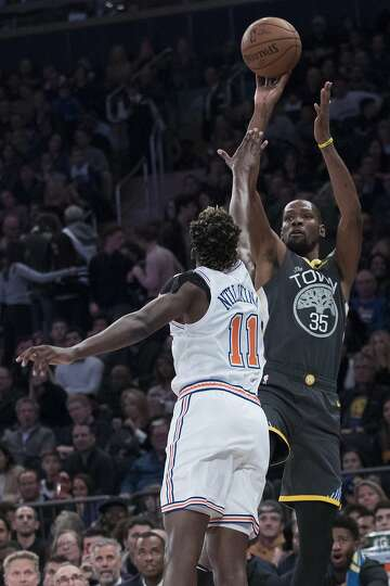 02f06c65029 3of18Golden State Warriors forward Kevin Durant (35) shoots a three-point  goal over New York Knicks guard Frank Ntilikina (11) during the first half  of an ...