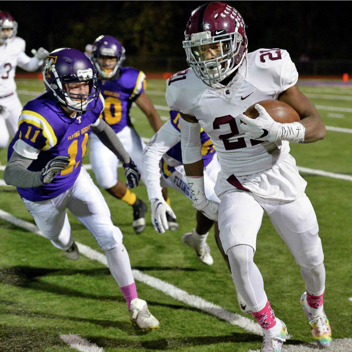 Here's Burnt Hills and Troy showing the modern Section II football game in October 2018. Continue viewing the slideshow to see the way football in the Capital Region used to look.